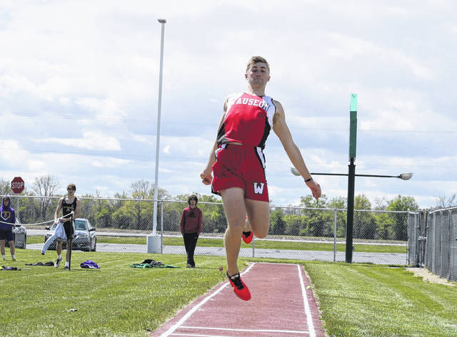 Wauseon's Noah Sauber soars in the long jump during day one of the NWOAL meet at Evergreen Tuesday. Sauber finished fourth with a jump of 19 feet, 1 inch.