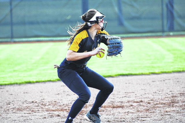 Archbold's Kylie Sauder makes a throw to first during Friday's 3-2 NWOAL win over Bryan. The Golden Bears' loss forced a tie for the league title between them and Evergreen.