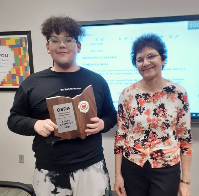 Senior Noah Harman, with WHS Speech and Debate Team Coach Delores Muller, was recognized as the state champion in his category at the 2021 Ohio Speech and Debate Association state tournament.