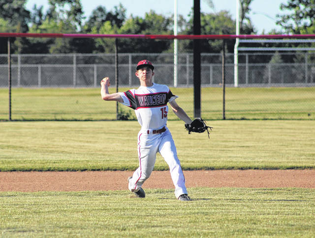 Wauseon's Ryan Marks throws over to first from his shortstop position during an ACME game with Holgate Thursday, June 17. The Indians went on to defeat the Tigers 17-10.