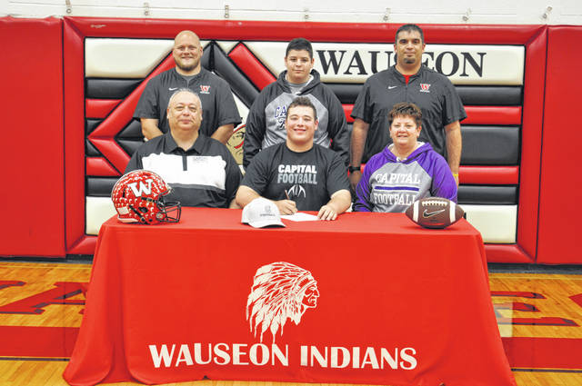 Hunter Nofziger of Wauseon recently committed to continue his education and football career at Capital University in Columbus, Ohio. Front row, from left: Matt Nofziger (father), Hunter, Lynelle Nofziger (mother). Back row: Wauseon assistant football coach Terry Lind, Kohen Nofziger (brother), Wauseon head coach Shawn Moore.