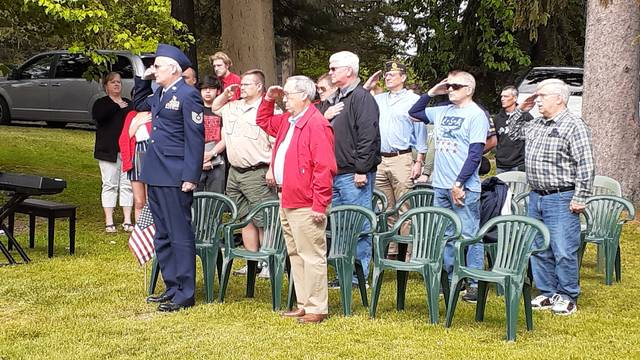 """Recognized Wauseon veterans stand at attention during the """"Star Spangled Banner."""""""