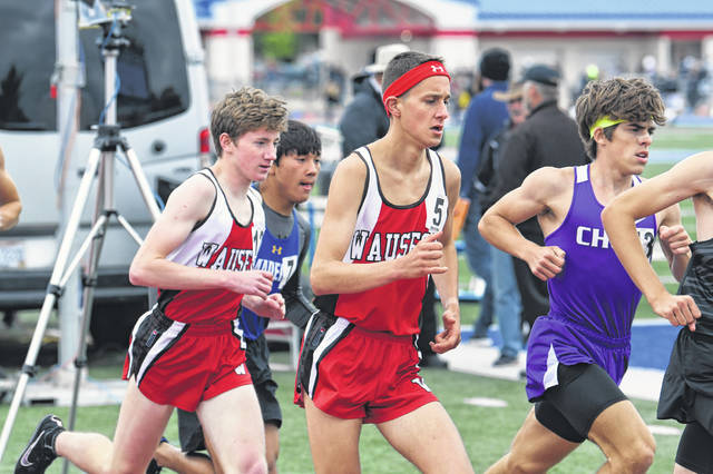 Wauseon's Braden Vernot, right, and Hunter Wasnich, left, run close together early on in the boys 3200m Saturday during the running finals of the Division II Piqua Regional.
