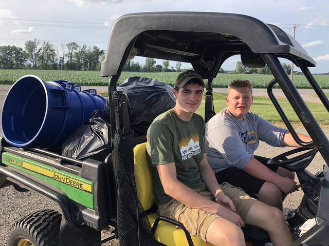 Pettisville FFA members Carson Bennet, left, and Jonah Harmon with trash duty.