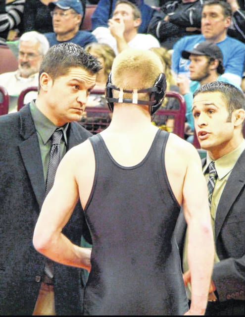 Delta's now former head wrestling coach Anthony Carrizales, right, and cousin Danny Carrizales coach up Luke Kern during the 2012 season. They helped Kern reach his goal of a state title at 138 pounds, which is one of Anthony's fondest memories as coach of the Panthers.