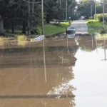 Floodwaters inundate area road