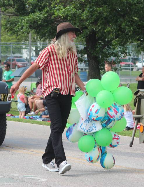 Steve Raker, 2021 Citizen of the Year, walks in the Chicken Festival parade on Saturday.