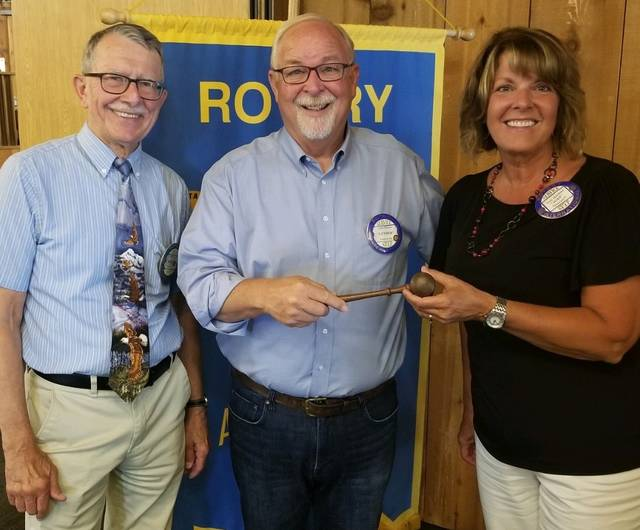 Luther Gautsche, center, became Archbold Rotary's 68th president on July 1, taking over the leadership of the club from Jodi Herman. Gautsche joined Archbold Rotary in October 1984. Dale Kern, left, is serving as Gautsche's assistant.