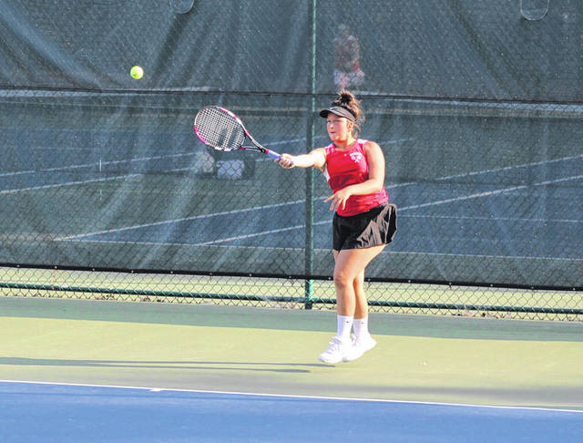 Wauseon's Tatum Barnes returns a shot during a match last season. Barnes, a senior, was first singles for the Indians in 2020.