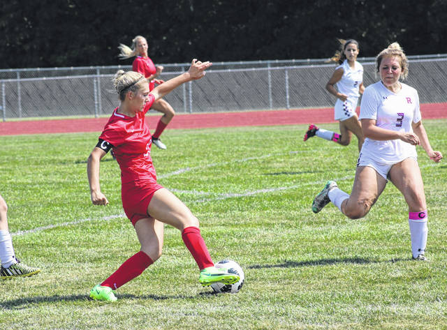 Wauseon's Kadence Carroll makes a move on a Rossford defender during the season opener Saturday afternoon. The Indians bested the Bulldogs 8-0 to begin the season 1-0.