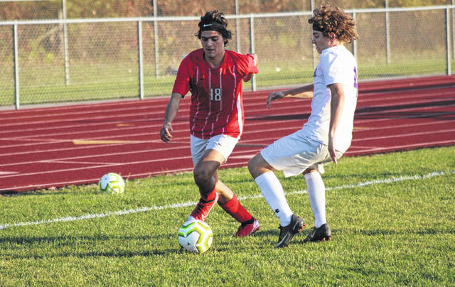 Eli Delgado of Wauseon, left, maneuvers his way around a defender during a tournament game last fall. He returns after being named first team all-league and second team all-district a season ago.