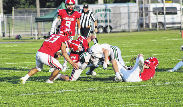 The Wauseon defense, led by Bryson Stump (44), swarms Tinora's Cole Anders Friday night. The Indians would fall to the Rams 23-13.