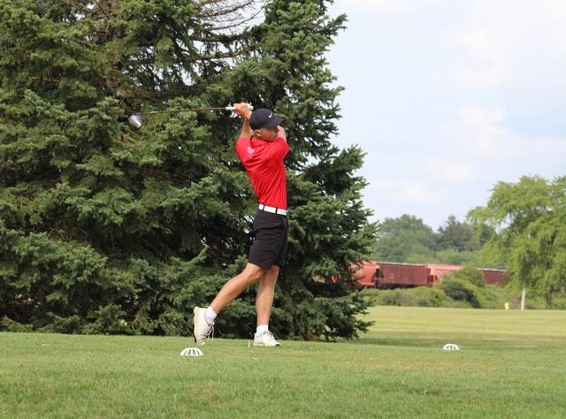 Andy Scherer of Wauseon follows through on his tee shot at the 10th hole at Ironwood Tuesday versus Paulding. He shot a 37 to propel the Indians over the Panthers.