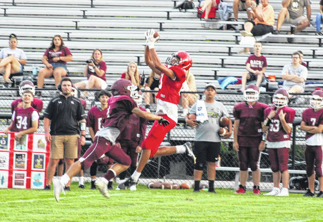 Wauseon wide receiver Sam Smith hauls in a pass over a Rossford defender during Friday's scrimmage. The Indians will open the regular season this Friday at Fairview.