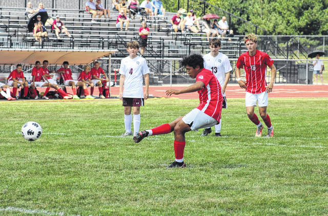 Benicio Torres of Wauseon converts a penalty kick at the 30:43 mark of the first half Saturday versus Rossford. He notched a pair of goals and multiple assists in the Indians' 9-0 victory over the Bulldogs.