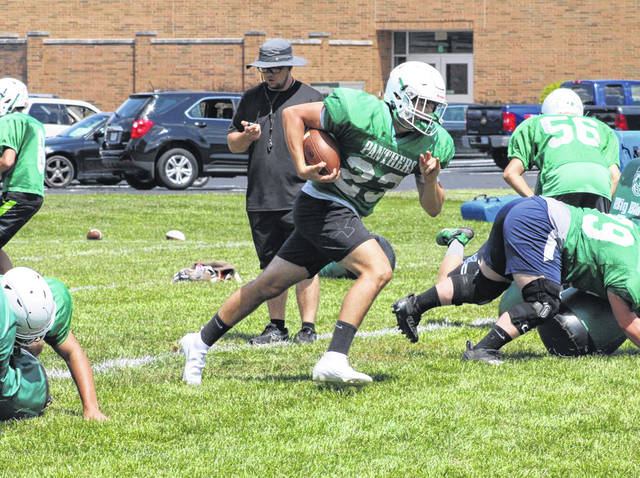 Josh Tresnan-Reighard cuts upfield as Delta practices a trap play during Monday's practice. The Panthers finished 4-4 last year in the shortened season.