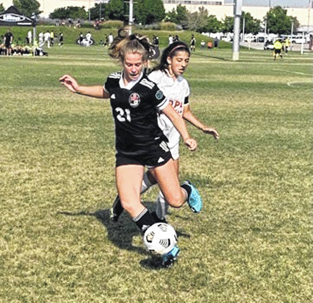 """<p style=""""text-align: left;"""">Raegan Radel, a sophomore-to-be at Evergreen this fall, plays in a game at the United States Club Soccer National Cup tournament held recently in Colorado. She was part of the U-15 girls soccer team at Pacesetter that won the National Cup title."""
