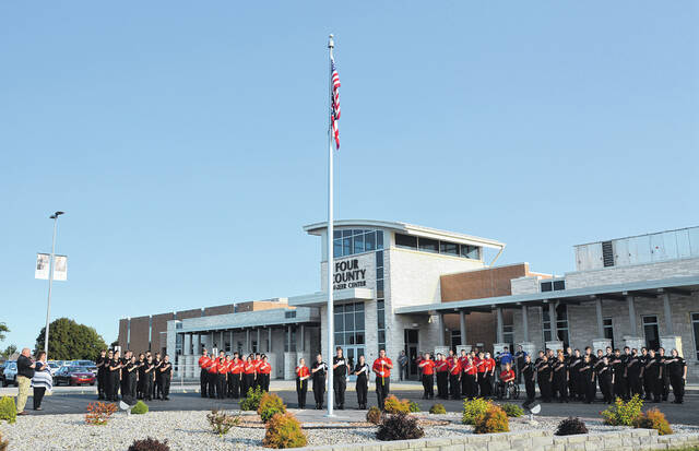 """As a tribute to those who lost their lives and to acknowledge the 20th Anniversary of 9-11, Four County Career Center students from the Fire & Rescue and Law Enforcement & Security Tactics classes, along with instructors Tonya Fisher and Kevin Thomas, held a Remembrance Ceremony in honor of """"Patriot Day."""" Members of the Color Guard included Law Enforcement & Security Tactics students Izabelle Wyse of Delta, William Douglass of Bryan, Summer Bates of Fairview, and Fire & Rescue students Saige Johnson of Wauseon, Travis Stoffer of Hicksville. Color Guard Law Enforcement & Security Tactics students lowered the flag to half mast in respect for the day. Following a moment of silence in respect for those who have sacrificed so that we may be safe, Taps was played by Ellie Cichocki from Napoleon."""