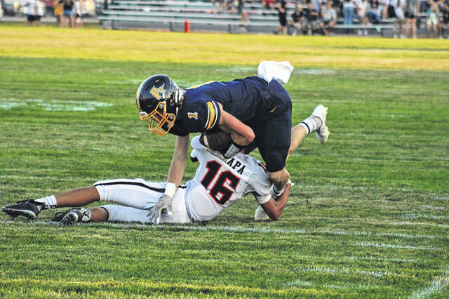 Archbold's Gavin Bailey fights for more yards on a play in the first half versus Liberty Center Friday night. Bailey caught seven passes for 94 yards and three touchdowns as the Blue Streaks rolled to a 41-7 win over the Tigers.