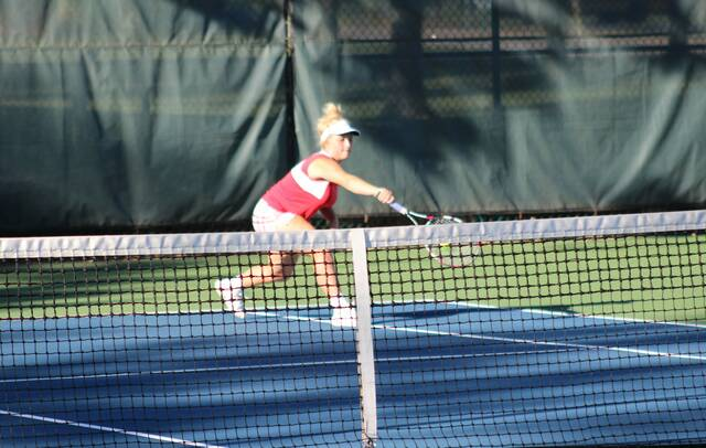 Tatum Barnes with a backhand for Wauseon in first singles versus Sydney Becher of Ayersville during Tuesday's match. She shut out Becher 6-0, 6-0 to aid the Indians in their 4-1 triumph over the Pilots.