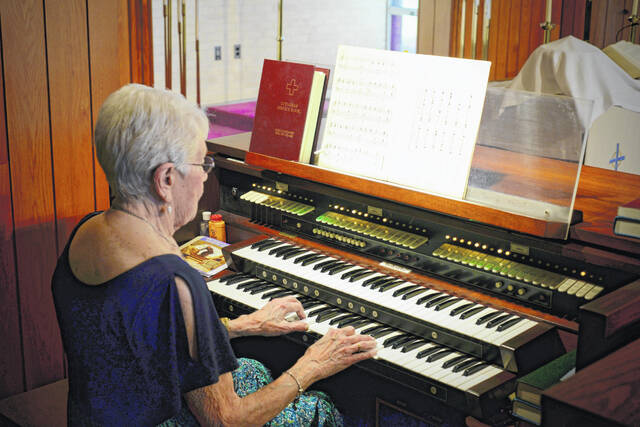 Marian Hurst plays the organ for one of nearly 3,000 career performances at Emmaus Lutheran Church in Wauseon.