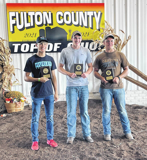 The boys champion Straw Loading Team was, from left, Hyatt Stamm, Carson Bennett, and Josh Norr from the Pettisville area.