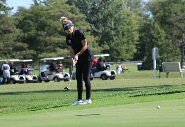 Calaway Gerken of Wauseon sends a putt towards the hole during the NWOAL Girls Golf Tournament at Auglaize Golf Club in Defiance Friday. The Indians would finish second at the inaugural tournament.