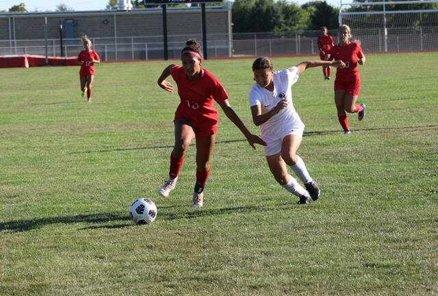 Wauseon's Aariyah Hallett, left, looks to beat Haylee Valle to a ball during a NWOAL girls soccer match last week. The Indians defeated the Blue Streaks by a 2-1 final.