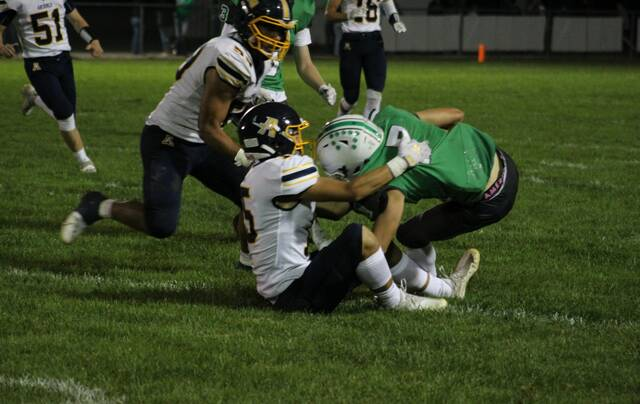 Jack Hurst of Archbold brings down Delta's Bryar Knapp during last Friday's NWOAL matchup. Archbold remained at the top of Division VI, Region 22 while Delta is at 12th, a spot higher than last week, in the latest OHSAA football computer ratings.