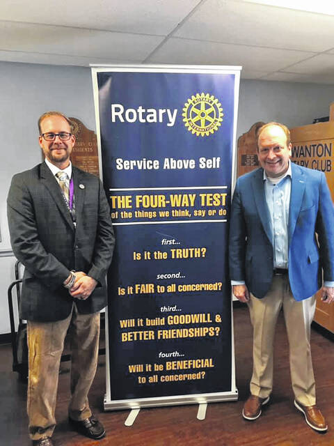 Ohio Supreme Court Justice Pat DeWine, right, stands with Swanton Rotary Club President Chris Lake on Thursday.