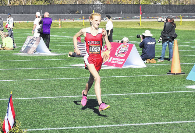 Grace Rhoades of Wauseon strides to the finish line at the OHSAA State Cross Country Championships a season ago. She finished 16th and returns for her junior season in 2021.