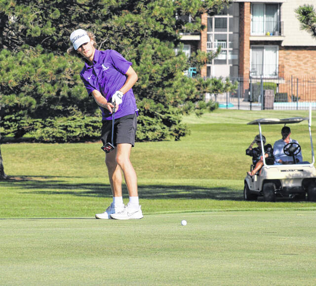 Swanton's Garrett Swank watches a putt towards the hole Thursday in a match versus Wauseon at Ironwood. He shot a 40 as the Bulldogs defeated the Indians, 170-197.