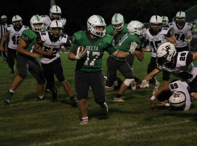 Delta running back Jerremiah Wolford with a nice run during Friday's contest with Paulding. Delta won 49-0 to close out their non-league slate.