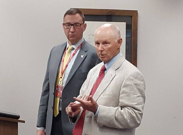 Wauseon's schools Superintendent Troy Armstrong, left, and Treasurer Dave Fleming offered information Monday to City Council about a proposed 2% earned income tax levy on the ballot Nov. 2.