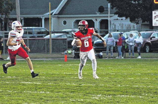 Wauseon quarterback Elijah McLeod scrambles out of the pocket Friday night versus Patrick Henry. The Indians handed the Patriots their second loss of the season, 21-6.