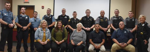 CIT training instructors were (front row), from left: Brenda Byers, Recovery Services of Northwest Ohio; Bethany Shirkey, Four County ADAMhs Board; Drena Teague, retired mental health social worker; Jamie Mendez, Napoleon police detective; and Dave Mack, Napoleon police chief. CIT class participants (back row) were Pioneer police officer Parker Phillips, Bryan K9 officer Matt Sammons, Bryan police officers Ricardo Amador and Mason Zuck, Napoleon police patrolman Ryan VonDeylen, Fulton County sheriff deputies Darren Ward and Noah Eisel, Defiance police lieutenant Steve Waldron, Defiance police patrolmen Tristan Sanders and Zachary Higgins, and Fayette police officer Nicole Ferguson.