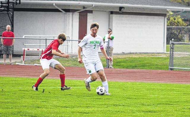 Delta's Nolan Risner works his way towards the Wauseon goal as Clay Soltis chases him down for the Indians. The two teams finished in a 3-3 tie.