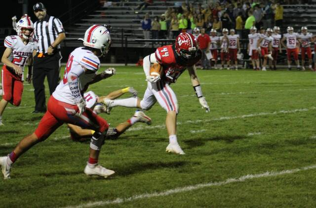 Wauseon tailback Bryson Stump runs the ball in a NWOAL matchup against Patrick Henry last Friday night. The Indians moved up one spot to 12th in the latest edition of the OHSAA computer ratings for Division IV, Region 14.