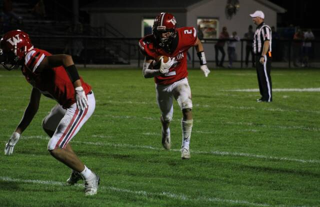 Wauseon's Jonas Tester goes around the left end after catching a short pass versus Patrick Henry last Friday. The Indians improved to 5-2 on the season after beating the Patriots, 21-6.