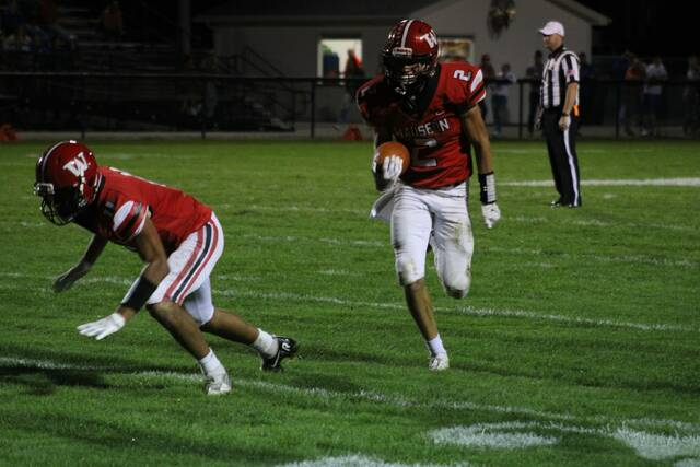 Wauseon's Jonas Tester takes a short pass around the left end as Sam Smith prepares to throw a block for him in a game against Patrick Henry this season. The Indians were ranked 11th in Division IV, Region 14, in the newest edition of the OHSAA football computer ratings released Tuesday.