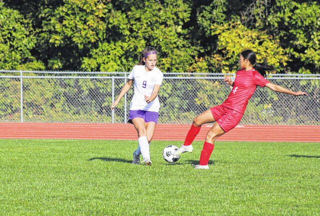 Swanton's Miranda Yeager, left, passes a ball upfield as Teagan Rupp of Wauseon tries to get her foot to it Thursday in NWOAL play. Yeager had a goal disallowed in the first half, while Rupp had the lone score for the Indians in their 1-0 win.