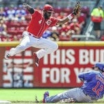 Reds pounds Cubs behind Leake