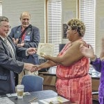 Aktion Club president recognized by commissioners