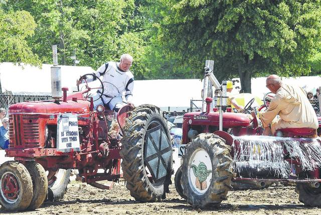 Skilled tractor drivers twirl around only inches apart during the Star Wars themed tractor square dancing at the 2016 Maria Stein Country Fest. The tractors and their drivers will be performing during this year's country fest planned for June 23-25.