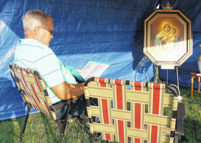 Roger Mack, of Botkins, takes part in a prayer vigil to end abortion held in a tent outside of Immaculate Conception in Botkins Wednesday, Sept. 27. The prayer vigil is part of the larger event 40 Days for Life which is a pro-life campaign.