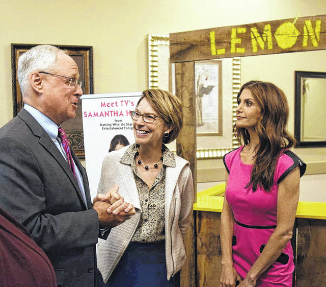 Bill McGraw, left to right, and his wife, Donna, talk with Samantha Harris at the annual Upper Valley Medical Center cancer symposium in Troy, recently.