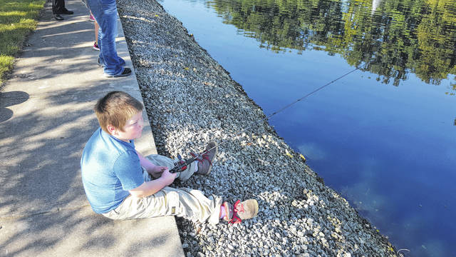 Little Brother Elijah Barger grandson of Cheryl Wolaver, waits patiently for a fish to bite at the Shelby County Bassmasters Fishing Derby.