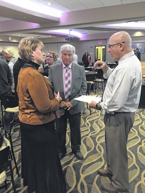 """At-large City Councilmember Joseph Ratermann and Third Ward Councilmember Ed Hamaker discuss the successes of Fairborn's Drug Court with Fairborn Municipal Court Judge Beth Cappelli Friday evening following the """"Bringing Humanity and Data to the Opiate Epidemic."""""""