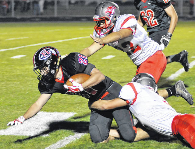 Fort Loramie's Carter Mescher fights for extra yardage during a game against Twin Valley South on Sept. 29.