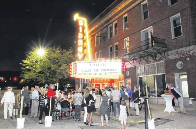 People gather around as the lights of the new Historic Sidney Theatre marquee are turned on for the first time Tuesday, Oct. 4. A party was held with a live band that played music from when the theatre was new. Donors were recognized for their contributions. There was a countdown from 5 to turn the marquee lights on.